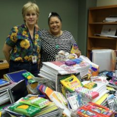 Two women with school supplies