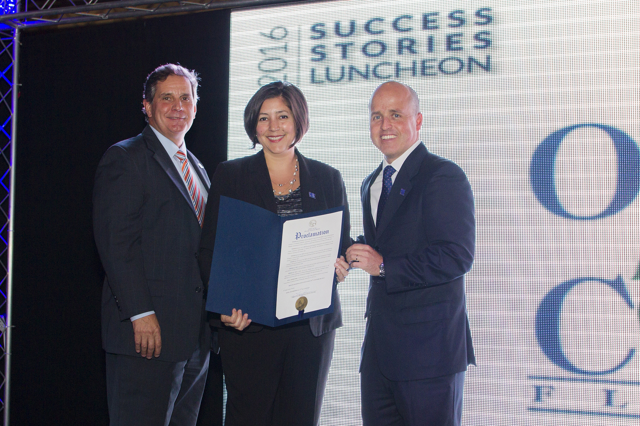 Three individuals with Business initiative proclamation