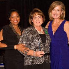 Mayor Jacobs with two women