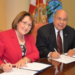 Mayor Jacobs signing for partnership with a small business administration