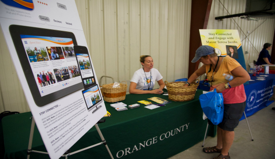 OC employee working a booth for Hurricane Expo