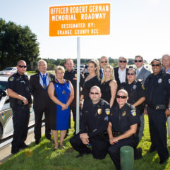 OC personnel at sign unveiling