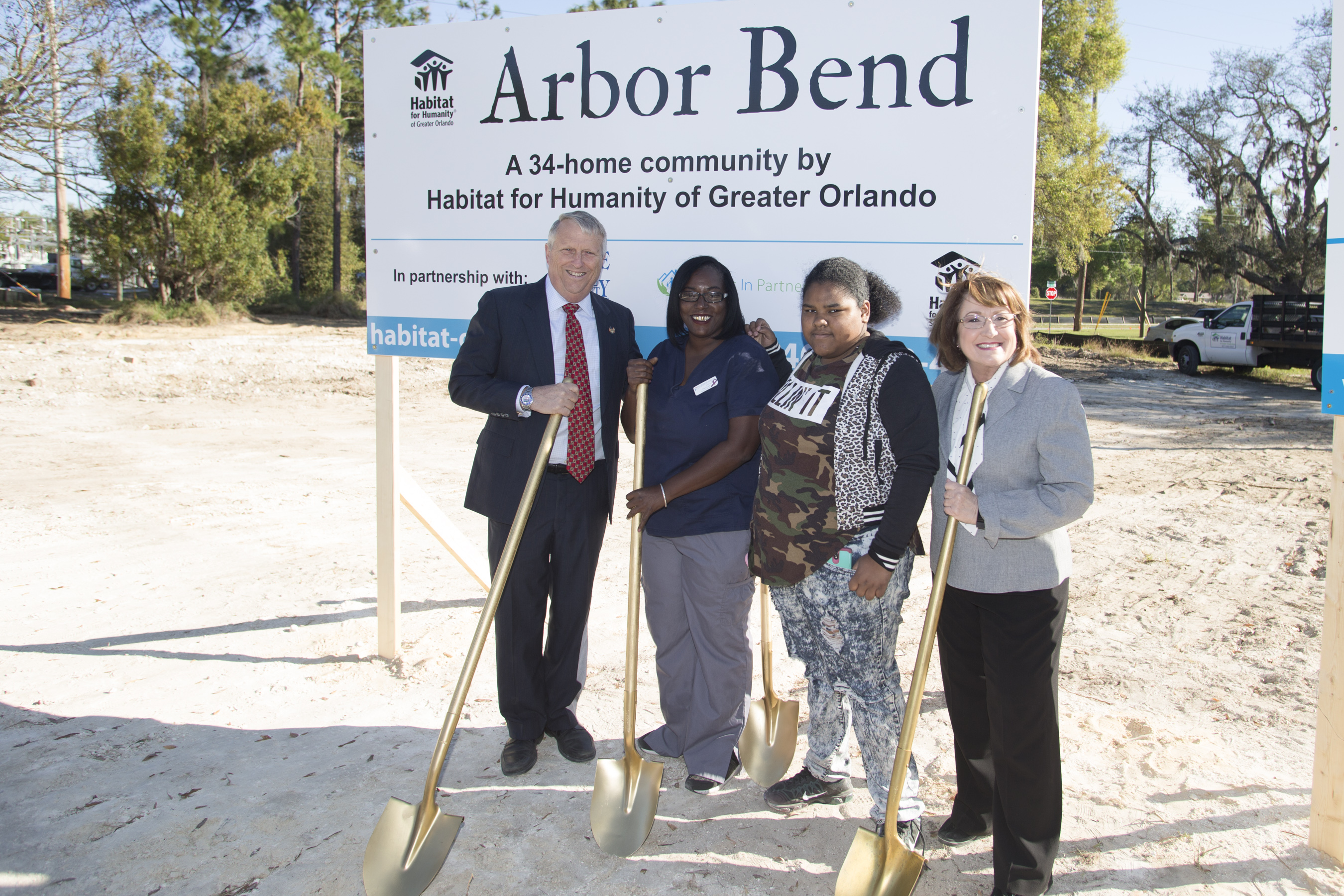 Mayor Jacobs, Commissioner Nelson and two individuals at the Arbor Bend groundbreaking