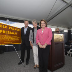 Mayor Jacobs and two individuals at the unveiling of the Arnold Palmer Expressway Sign