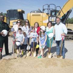 [L-R] Orange County Sherriff Jerry Demings, Orange County District 1 Commissioner Betsy VanderLey, Deputy Pine's wife Bridget Pine, Orange County Mayor Teresa Jacobs, Orange County Public Schools Board Member Pam Gould and former District 1 Commissioner S. Scott Boyd joined Deputy Pine's children to celebrate the groundbreaking of the Deputy Scott Pine Community Park.