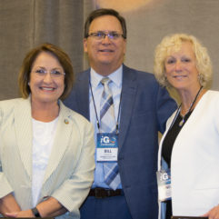 Mayor Jacobs with two individuals at the International Association of Government Officials Conference