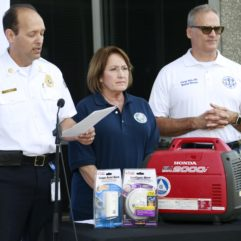 Mayor Jacobs with a generator and emergency personnel