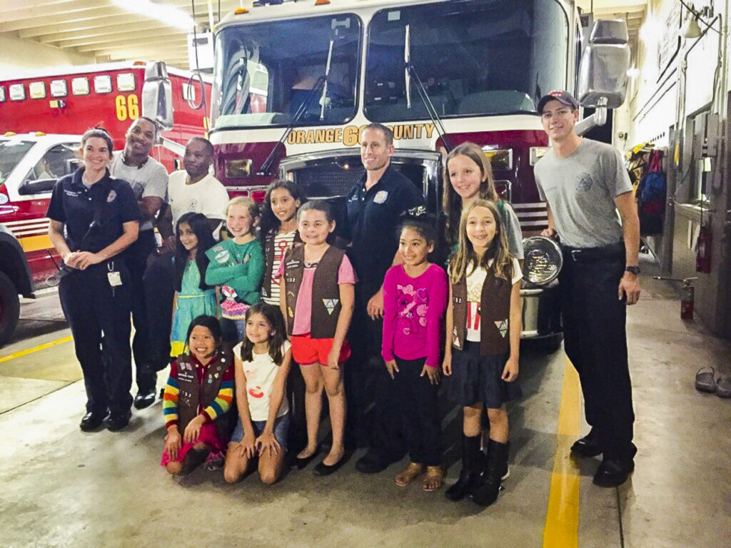 Kids with Orange County Fire Rescue at the Holiday Heroes Toy Drive