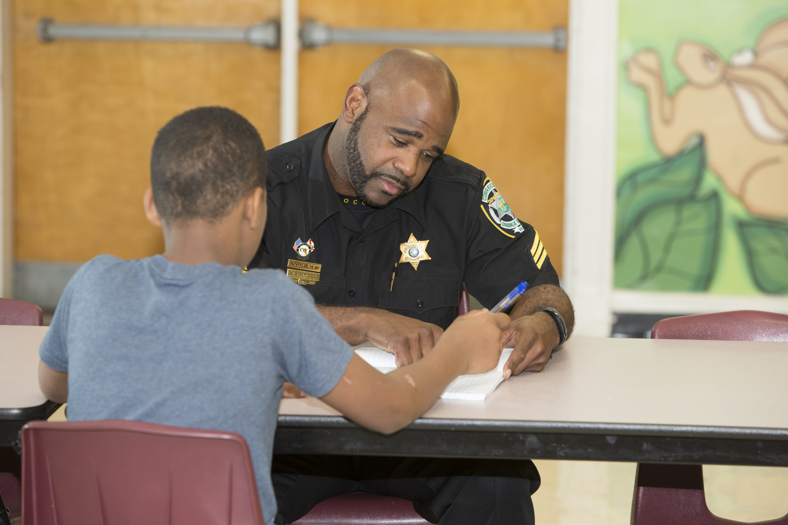 Corrections officer mentoring a student