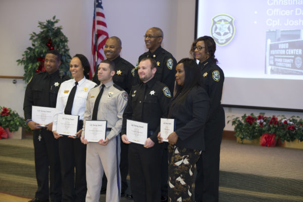 OCFL Corrections officers holding awards