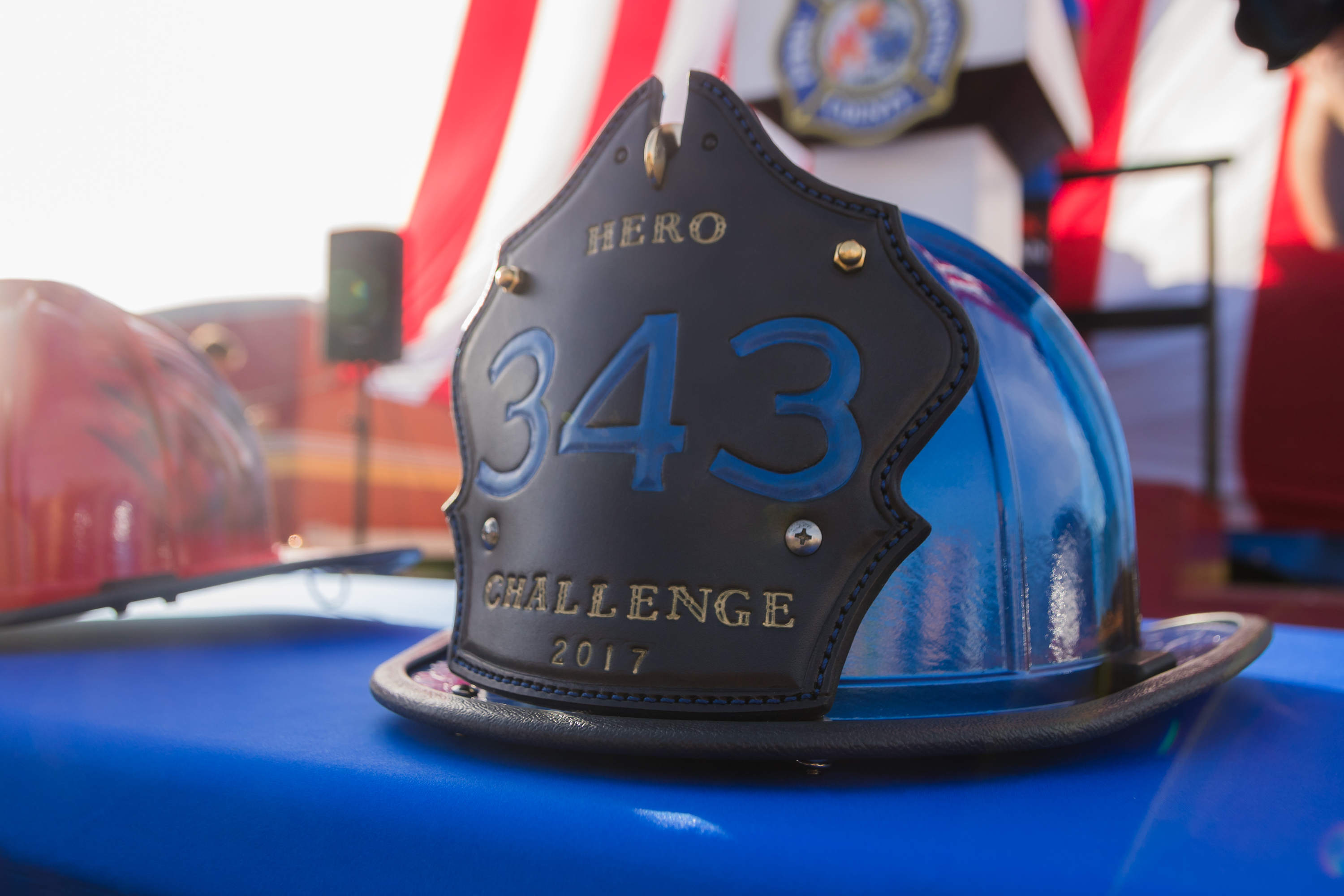 "Firefighter's blue helmet that reads ""343 Hero Challenge"""