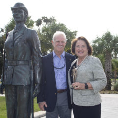 Mayor Jacobs and a man standing alongside a statuette