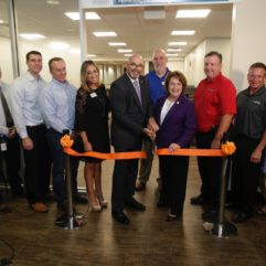 Mayor Teresa Jacobs and orange county employees posing for a ribbon cutting