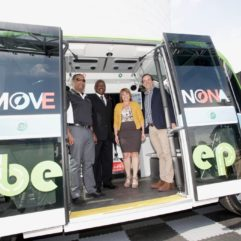 Mayor Demings, Commissioner Gomez Cordero, and two leaders are standing inside an autonomous bus made by Beep.