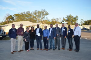 A group of eleven stands side by side for a photo. The group includes Orange County Mayor Jerry Demings and the Habitat for Humanity Orlando and Osceola CEO.