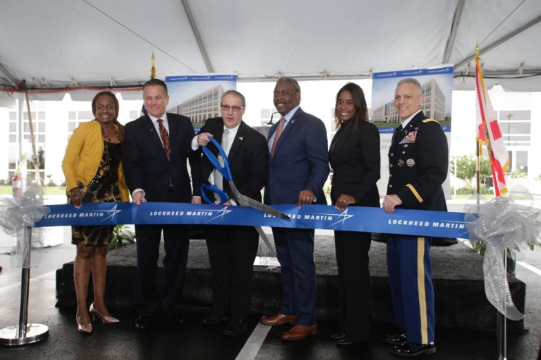 Orange County Mayor Jerry Demings joins five other community leaders and Lockheed Martin executives to cut the commemorative ribbon for Lockheed Martin's Research & Development II facility.