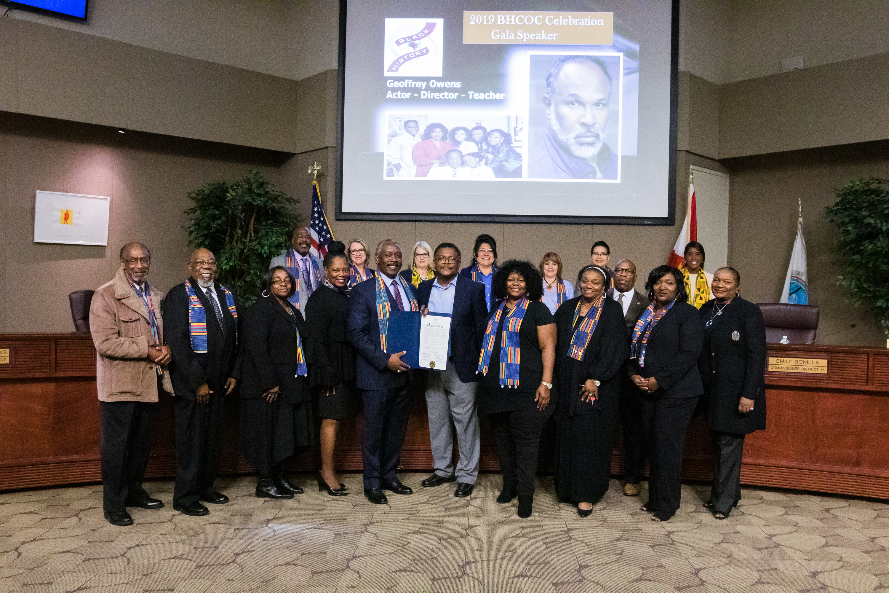 Mayor Demings holding the proclamation he and the rest of the Board of County Commissioners issued recognizing Black History Month in Orange County. The board and the Black History Committee of Orange County stand in the Chambers.