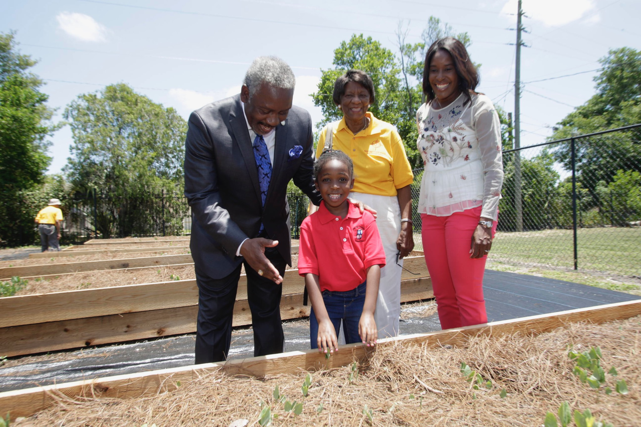 Mayor Demings and a child at a community garden