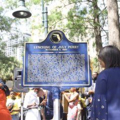 "Photo of the July Perry marker that reads ""Lynching of July Perry, November 3, 1920"""