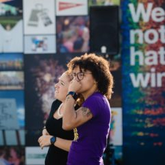 Two people stand in front of the Pulse memorial as they contemplate the artwork on display