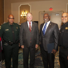 ] Orange County Corrections staff member Linda A. Brooks, Orange County Undersheriff Mark Canty, Florida Secretary of Corrections Mark Inch, Orange County Mayor Jerry Demings, and Orange County Corrections Chief Louis A. Quiñones, Jr.