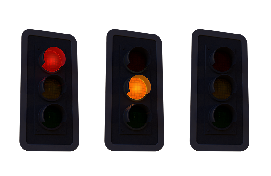 Three traffic lights, one is turned to red, another to yellow, and the last one is off completely
