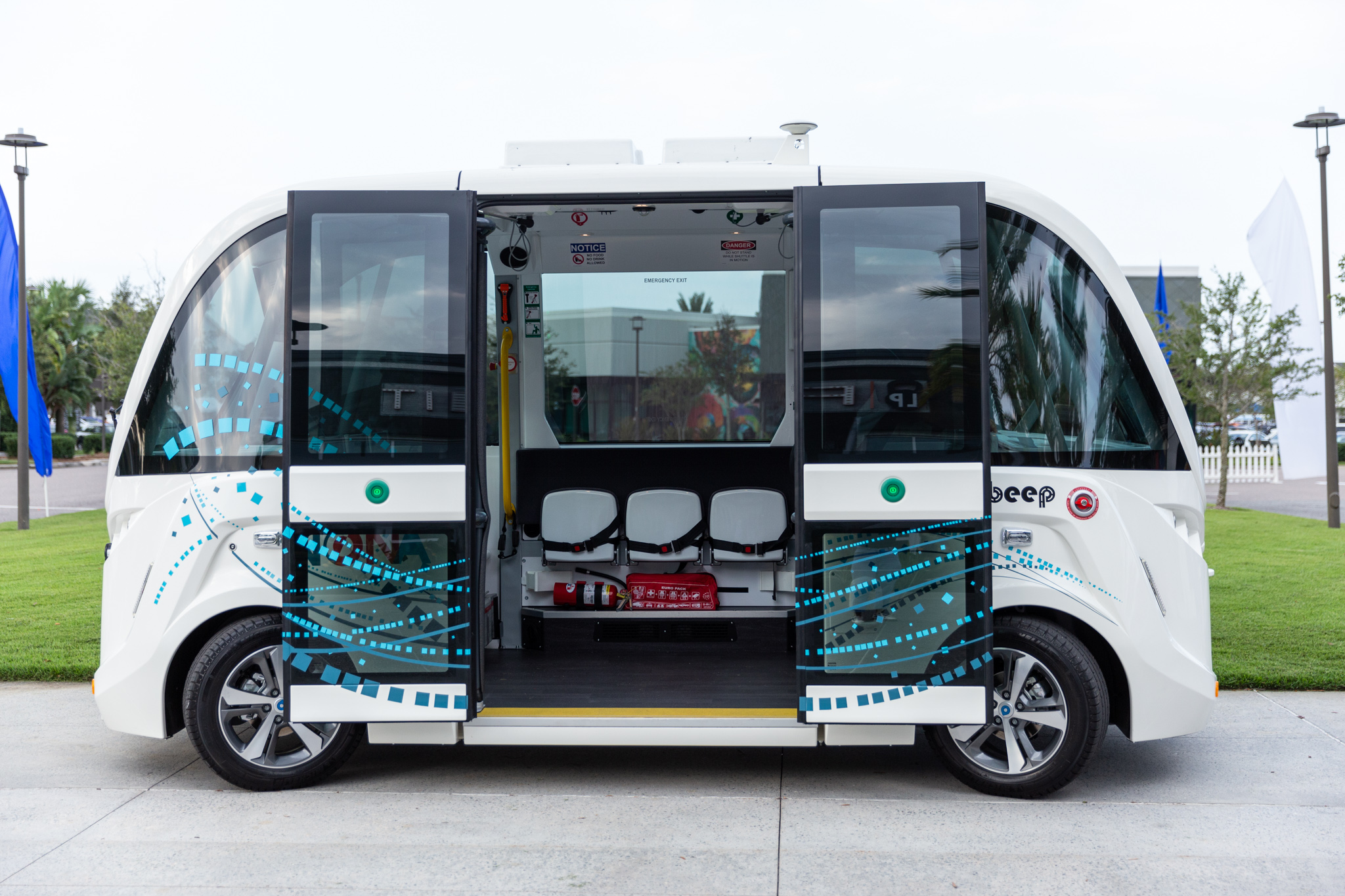 Beep's autonomous vehicle parked with its doors open