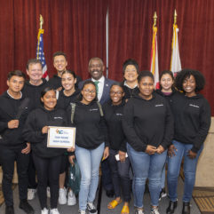 Isue Sopron pictured with his classmates and Mayor Demings at the Youth Leadership Conference