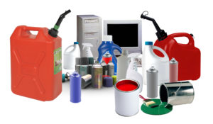 Photo featuring examples of household hazardous and electronic waste: gas cans, cleaners, spray cans, paint, computer and monitor.