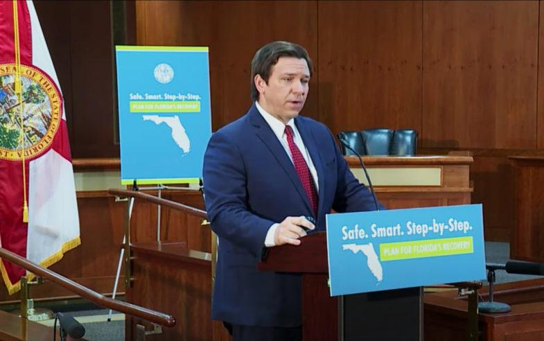 Governor Desantis at the podium