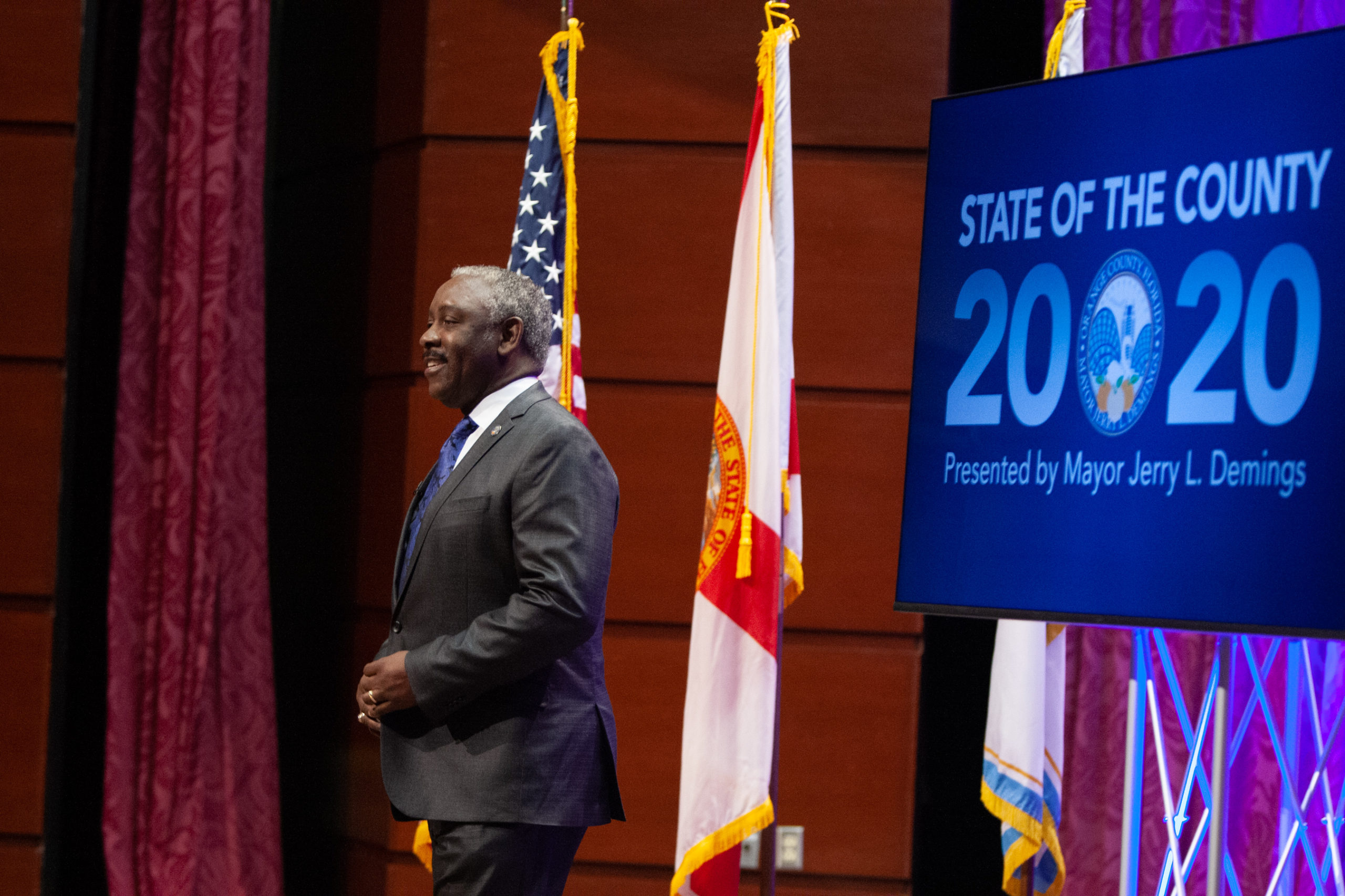 Mayor Demings standing on stage during the 2020