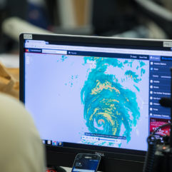 computer screen showing a hurricane on radar