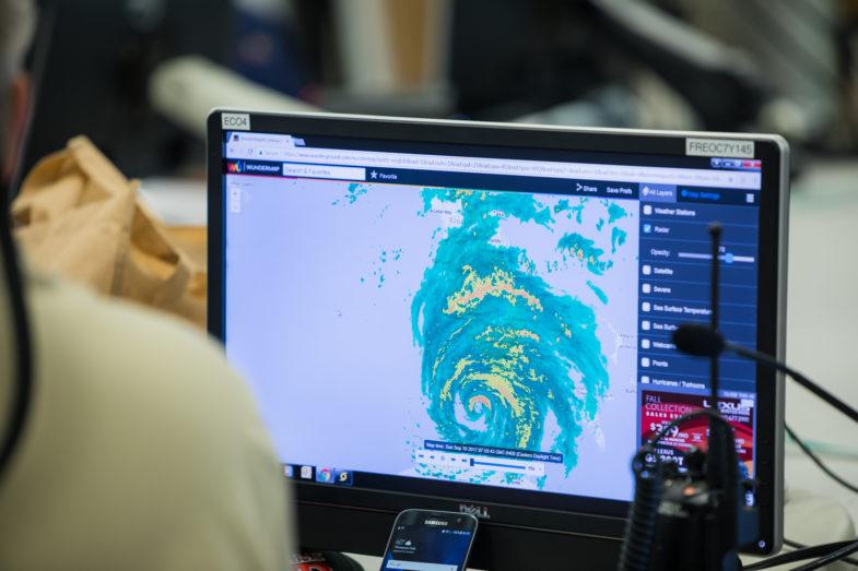 computer screen showing a hurricane on radar