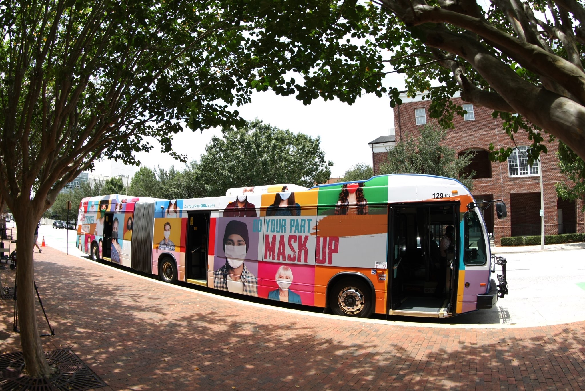 Large LYNX bus wrapped with an advertisement for the Safer, Stronger, Together campaign