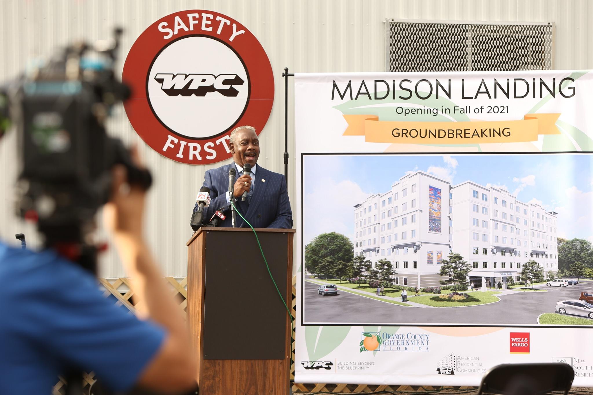 Mayor Demings speaks at Madison Landing's groundbreaking at a podium