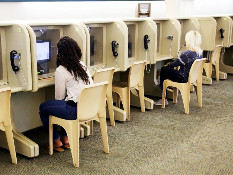 A row of video-enabled booths at the visitation center