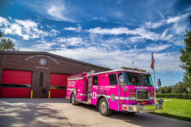 Pink fire truck at a fire station