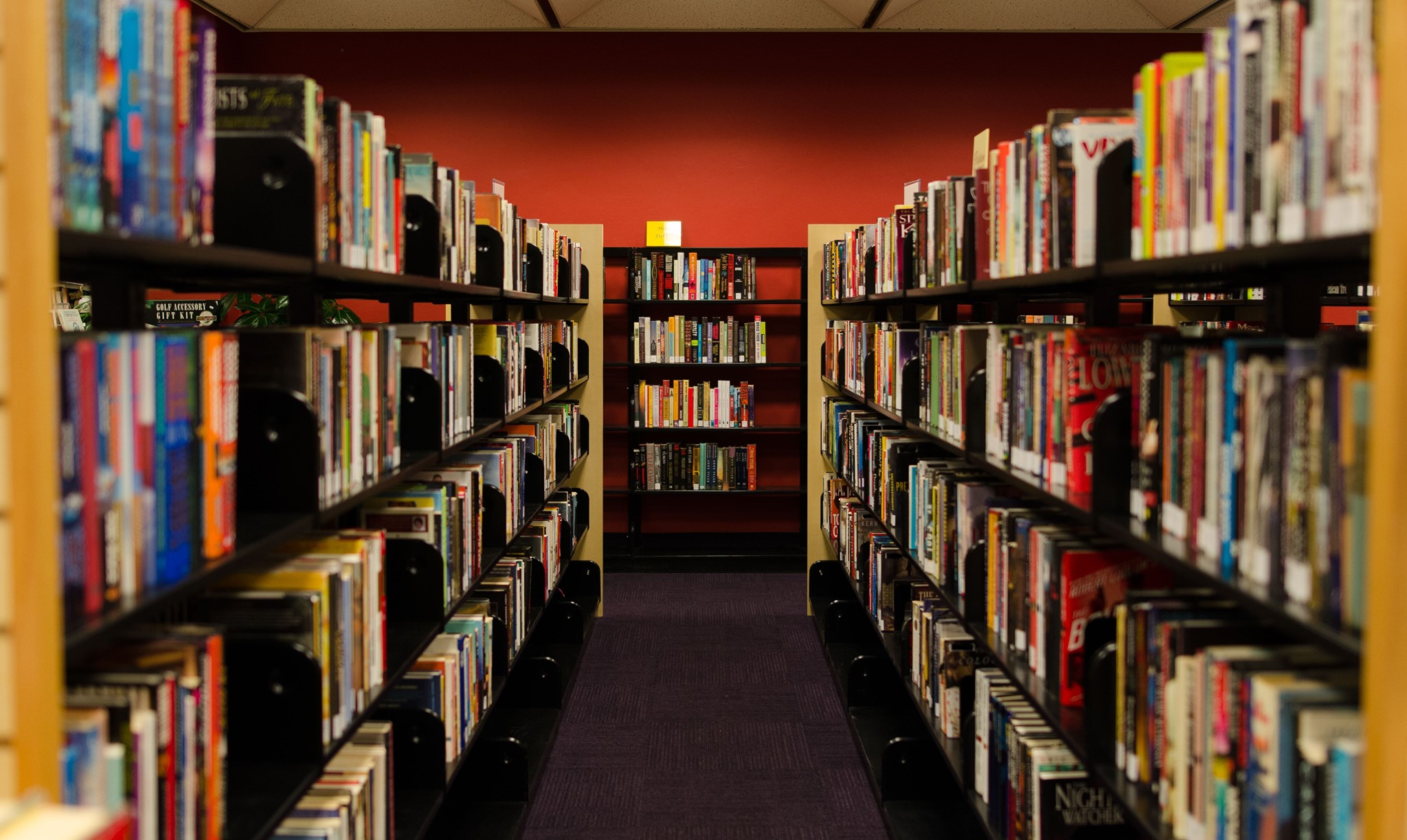 row of books on shelves in library