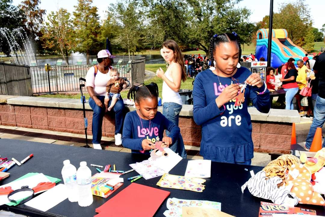 Residents participating in a community celebration in District 6's Barnett Park.