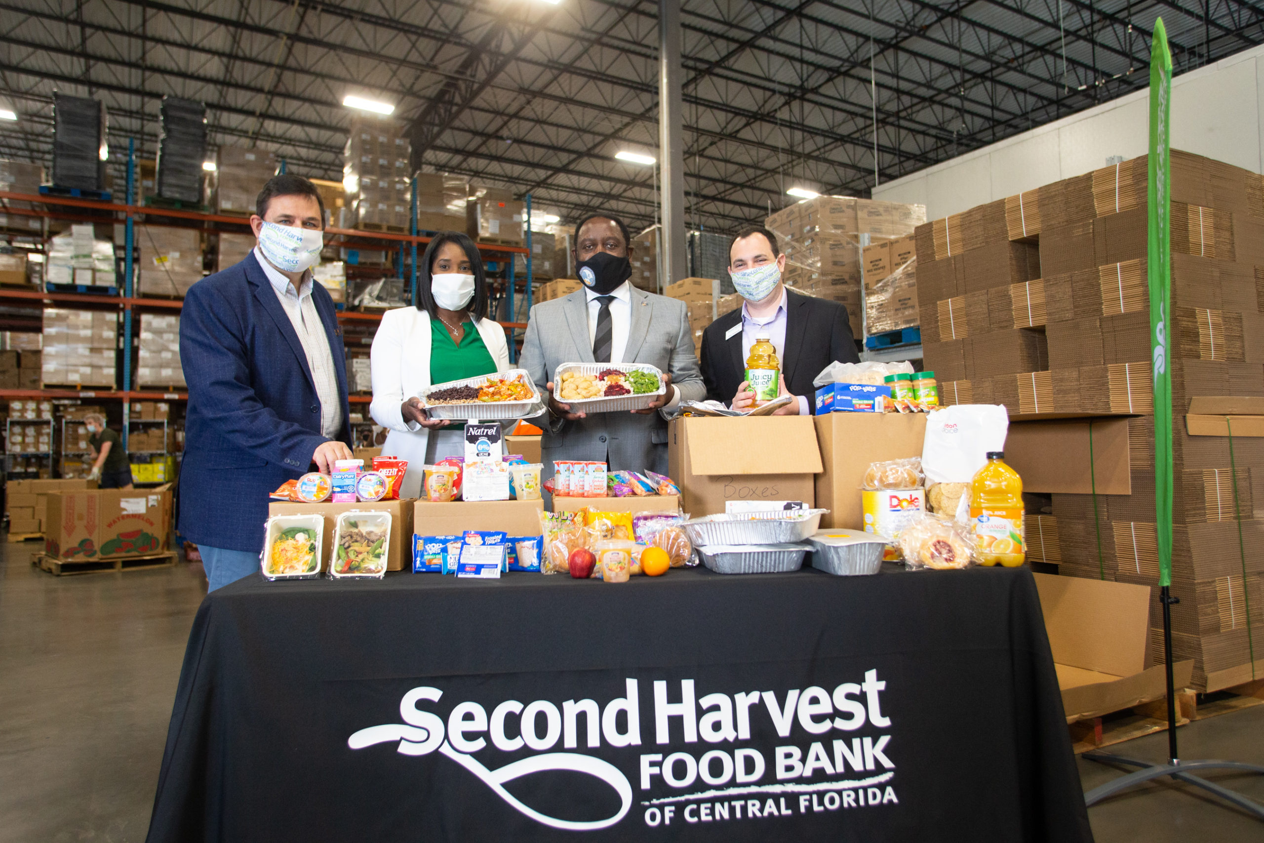 Chief Development Officer at Second Harvest Food Bank of Central Florida Greg Higgerson; District 6 Commissioner Victoria P. Siplin; Orange County Mayor Jerry L. Demings; and Director of Philanthropy at Second Harvest Dan Samuels celebrate the opening of Mercy Kitchen.