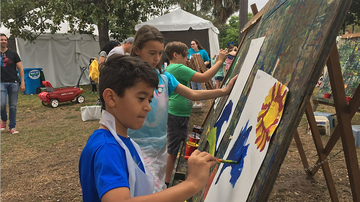 Children painting at the Winter Park Sidewalk Art Festival. (Ruben Almeida, Spectrum News)