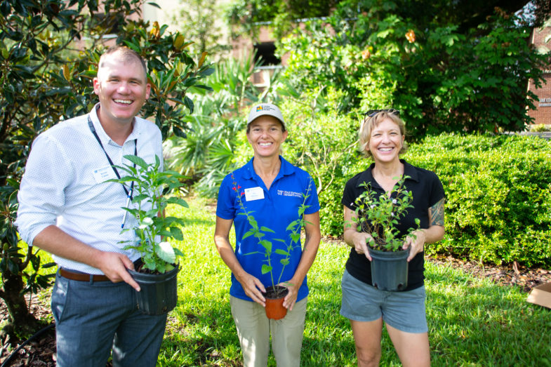 Tia Silvasy and other volunteers from the UF/IFAS Extension Orange County getting ready to plant Florida-friendly plants at the Orange County Admin Building.